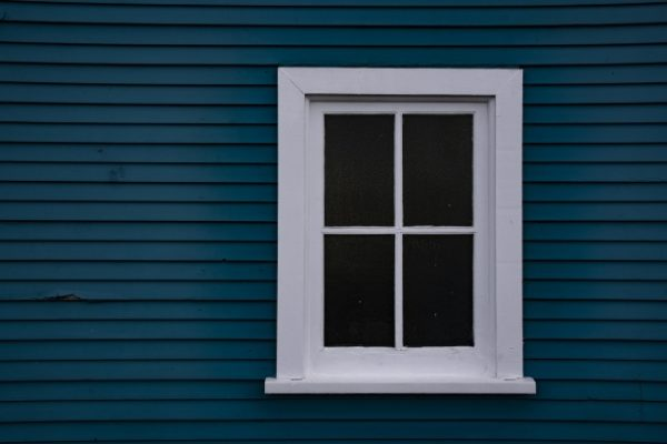 white-framed-wood-window-on-blue