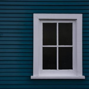 white-framed-wood-window-on-blue
